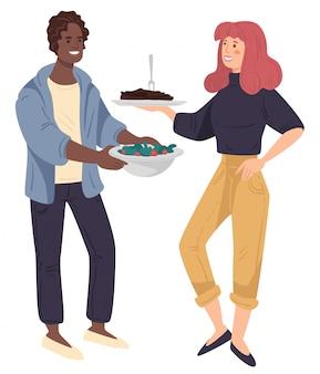 Homem e mulher segurando dih com carne e vegetais no prato