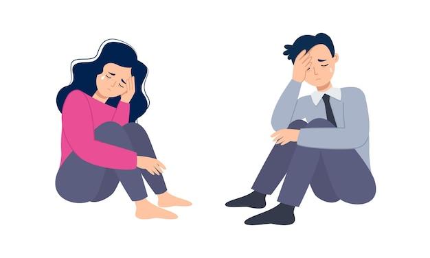 Homem e mulher sentem estresse e, sentados no chão, depressão e conceito de saúde mental