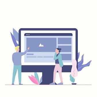 Homem e mulher trabalham juntos. tela grande mostrando o site. trabalho em equipe.