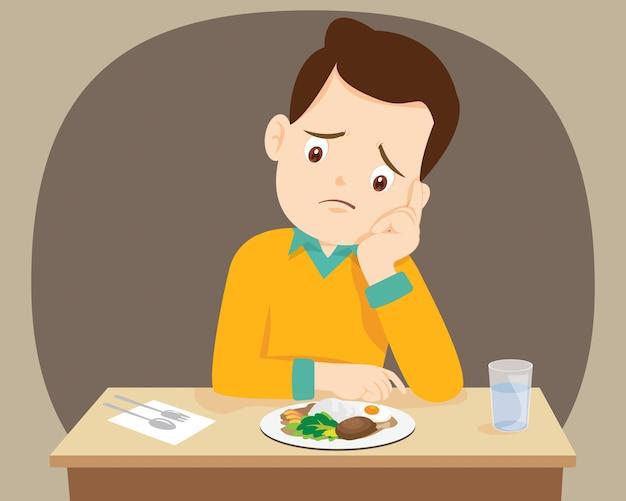 Homem entediado com comida não quer comer