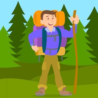 Homem escalador andando na floresta