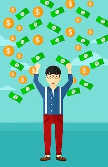 Homem feliz com dinheiro a voar.