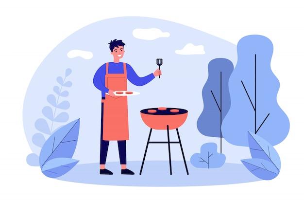 Homem feliz, cozinhar carne de churrasco ao ar livre