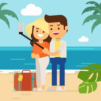 Homem feliz e mulher na praia nas férias de verão, casal turístico na ilha tropical com sua bagagem fazendo selfie