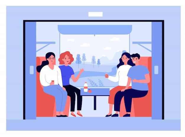 Homem feliz e mulheres viajando de trem