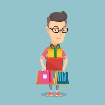 Homem feliz que guarda sacos de compras e caixas de presente.