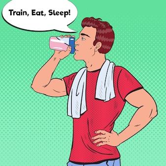 Homem fisiculturista bebendo batido de proteína