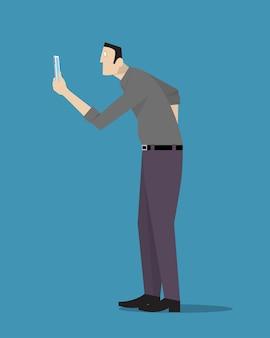 Homem hipnotizado pelo telefone