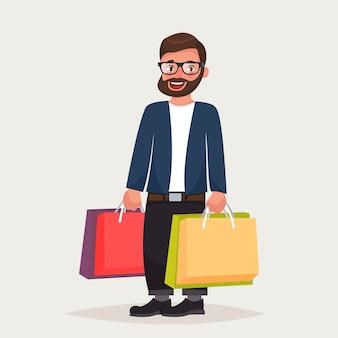 Homem hipster barbudo de óculos é fazer compras