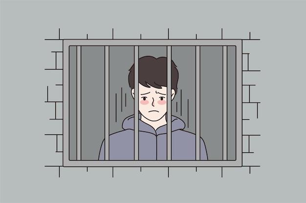 Homem infeliz condenado atrás das grades na prisão