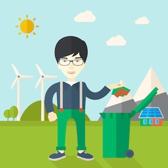 Homem jogando papel em uma lata de lixo