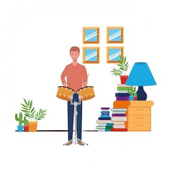 Homem jovem, com, timpani, em, sala de estar