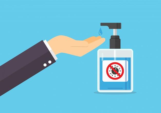 Homem lava as mãos com sabão da garrafa da bomba desinfetante