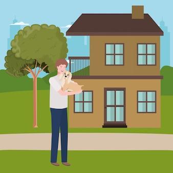 Homem levantando mascote de cachorro na casa ao ar livre