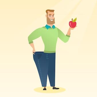 Homem magro nas calças mostrando resultados de sua dieta.