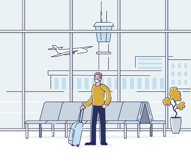 Homem mascarado com bagagem no terminal do aeroporto esperando a partida do avião durante uma epidemia macabra