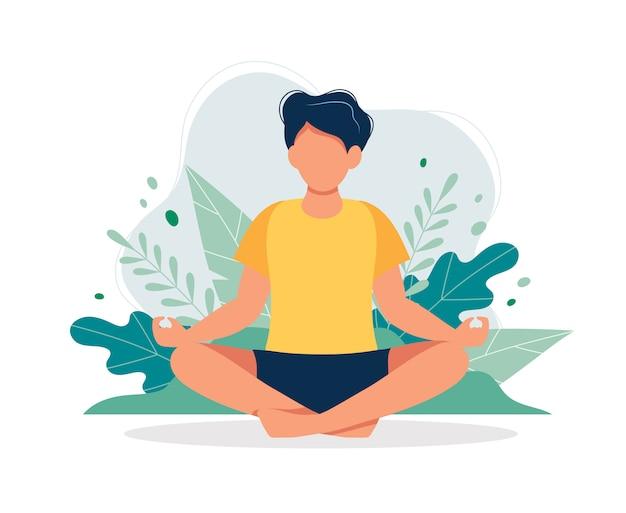 Homem meditando na natureza e folhas.