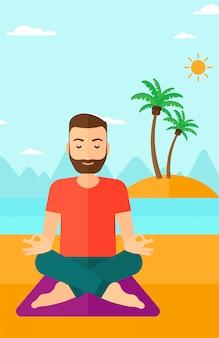 Homem meditando na posição de lótus.