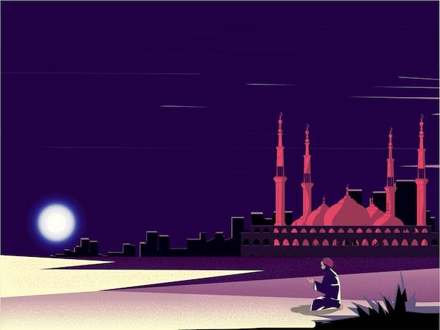 Homem muçulmano fazendo rezar no ramadã no deserto com a mesquita