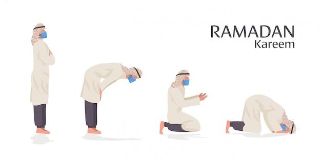 Homem muçulmano religioso na máscara orando posições ramadan kareem mês sagrado pandemia de coronavírus