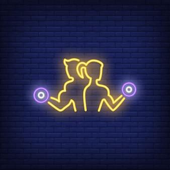 Homem mulher, treinamento, com, dumbbells, sinal néon