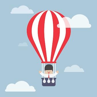 Homem negócios, em, balão ar quente