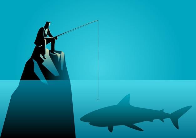 Homem negócios, pesca um tubarão