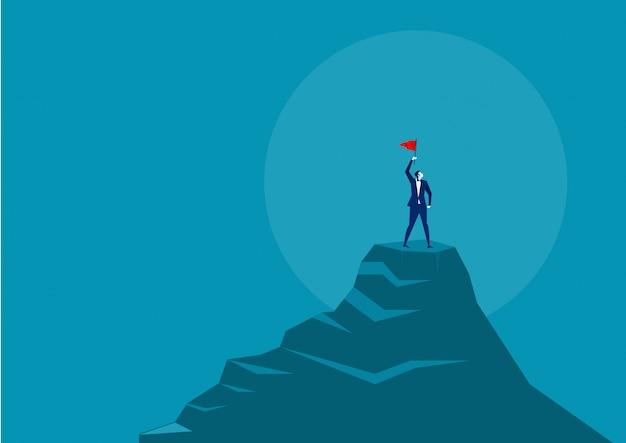 Homem negócios, segurando, bandeira vermelha, e, ficar, auge, a, montanha