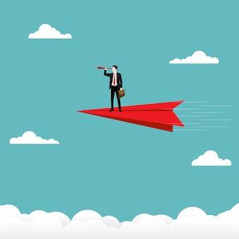 Homem negócios, segurando, um, binocular, levantar, ligado, vermelho, avião papel