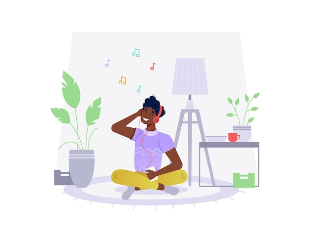 Homem negro afro-americano ouve música em casa sentado no chão.