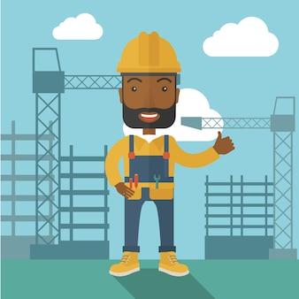 Homem negro que está na frente da torre do guindaste de construção.