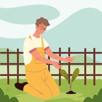 Homem no campo de plantio