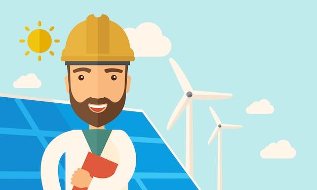 Homem no painel solar e moinhos de vento.