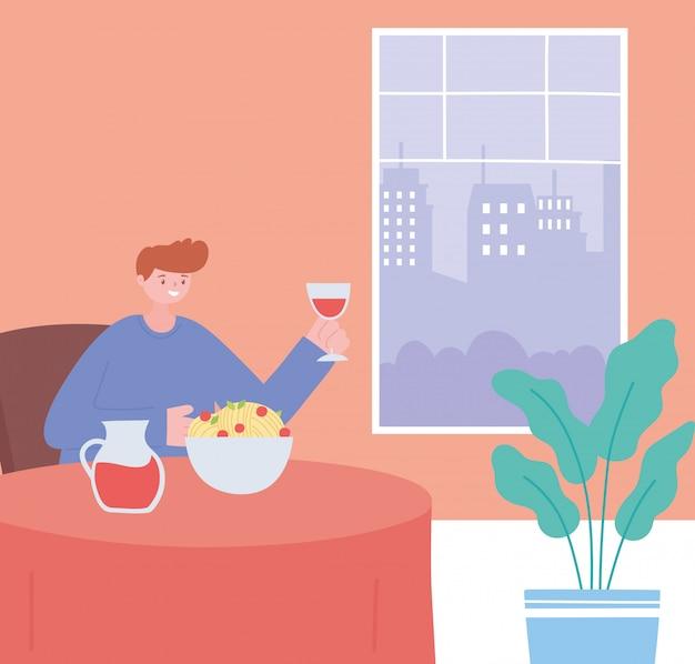 Homem no restaurante comendo e bebendo sozinho por causa de restrições sociais de distanciamento, 19 pandemia