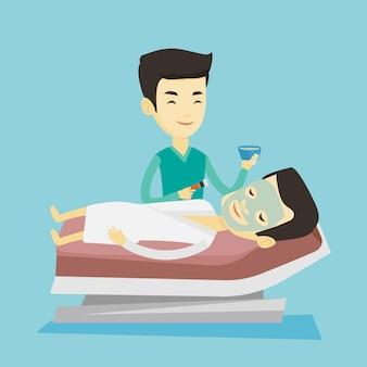 Homem no salão de beleza durante o procedimento de cosmetologia.