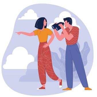 Homem olhando através de binóculos e uma mulher apontando na direção.