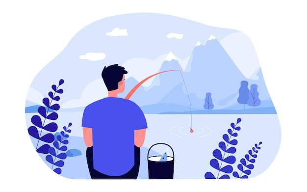 Homem pescar na margem do lago de montanha. ilustração em vetor plana. jovem, segurando a vara de pescar, admirando a bela paisagem montanhosa. pesca, natureza, solidão, hobby, conceito de férias