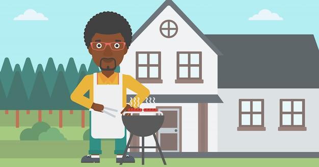 Homem preparando churrasco.