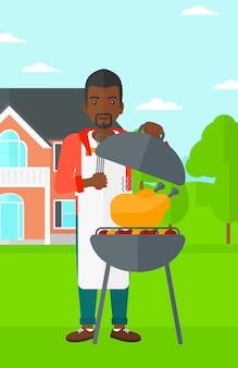 Homem preparando churrasco