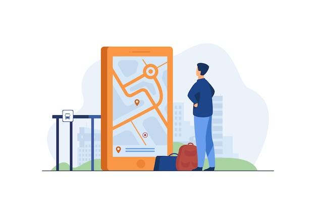 Homem procurando a rota no mapa no aplicativo móvel.