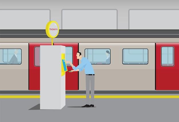 Homem que compra bilhetes de metrô na máquina de venda automática de self-service.
