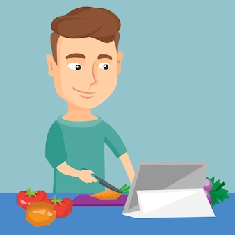 Homem que cozinha a salada vegetal saudável.