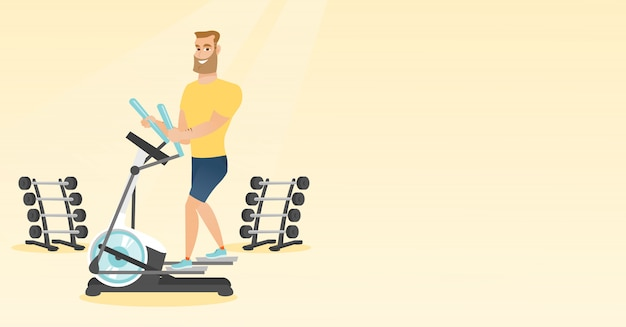 Homem que exercita no instrutor elíptico.