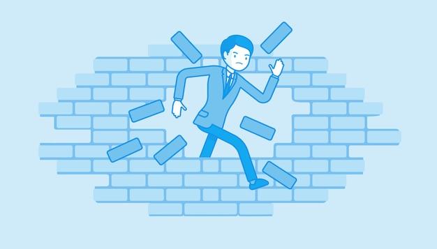 Homem quebrando a parede de tijolos