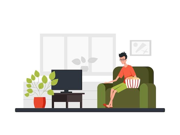 Homem se senta em um sofá, come um grande balde de pipoca e assiste tv. vista frontal. ilustração plana dos desenhos animados de vetor de cor. conceito de quarentena de epidemia de coronavírus. fique em casa.
