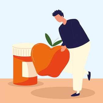 Homem segura maçã e remédio