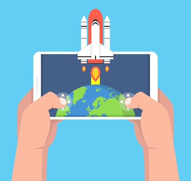 Homem segurando o smartphone e jogando no jogo de foguetes