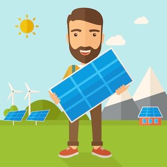 Homem segurando um painel solar.