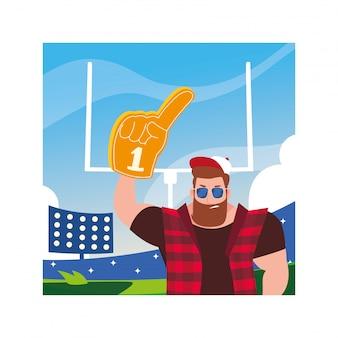 Homem segurando uma luva de mão com ventilador número 1, dedo de espuma amarela no estádio