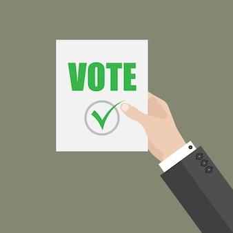 Homem segurar na mão um pedaço de papel com voto. conceito de votação